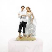 Bryllupsfigur med brudepar på stranden