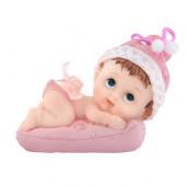 Barnedåbsfigur pige ligger på pude